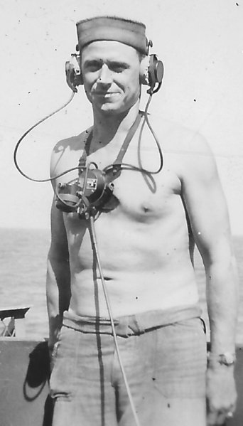 United States Navy sailor with sound powered telephone